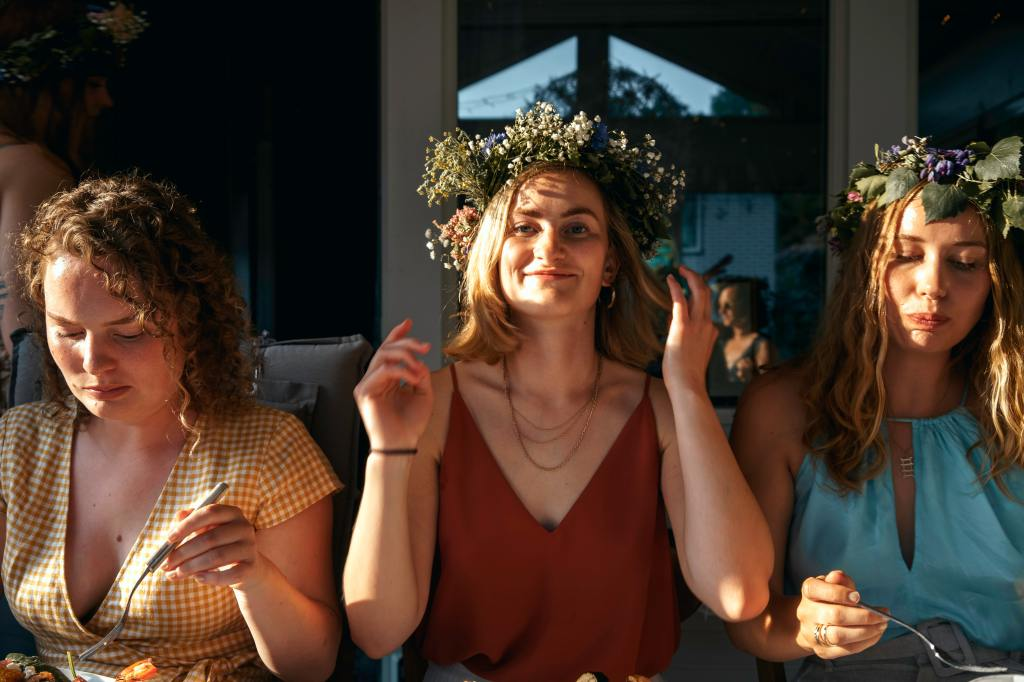Swedish girls with traditional flower wreaths.